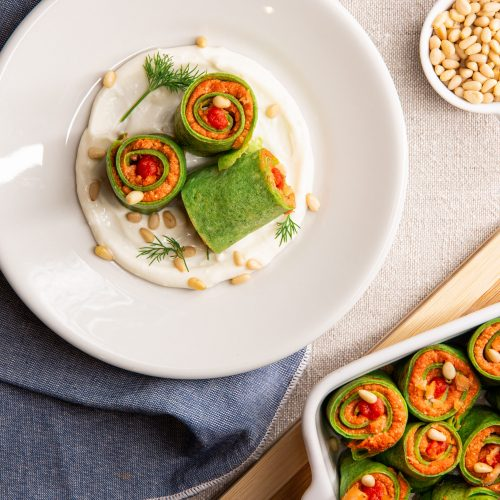 Green crepes with a salmon filling and toasted pine nuts  Draft