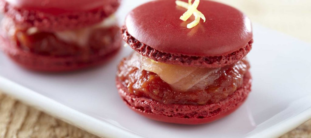 Smoked salmon macarons with finely chopped tomatoes