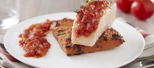 Salmon with thyme confit, crispy polenta and chopped tomatoes with basil and onion